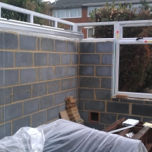 Block walls and no roof. Will this conservatory ever be ready for painting.
