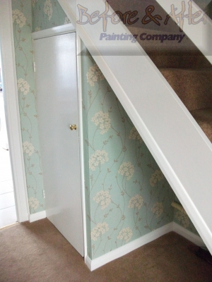 Duck Egg Blue wallpaper from Arthouse in a hall, stairs, landing in a Kent home.